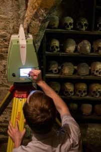 Figure 2. Setting up the Leica ScanStation in the charnel chapel.